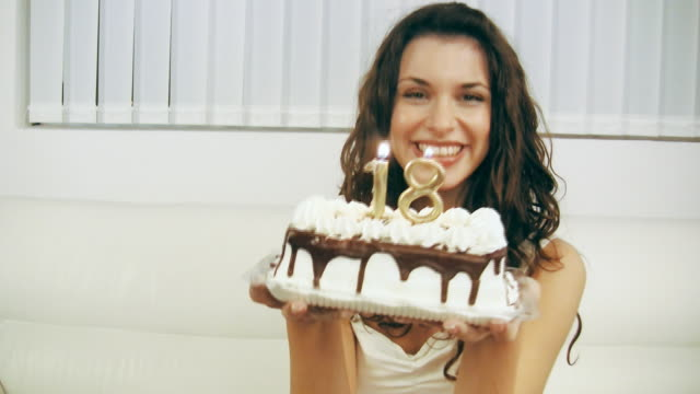 Girl Blowing Birthday Cake Candles 18 (HD Video) video