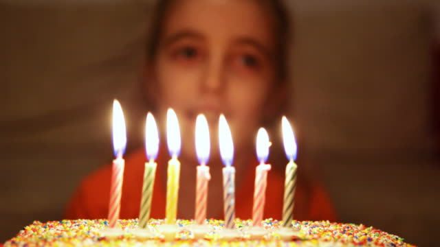 HD: Girl blowing birthday cake candles video