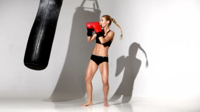 Girl boxer finished the training with a punching bag video