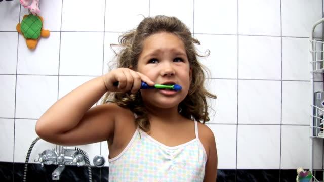 Girl brushing teeth (HD) video