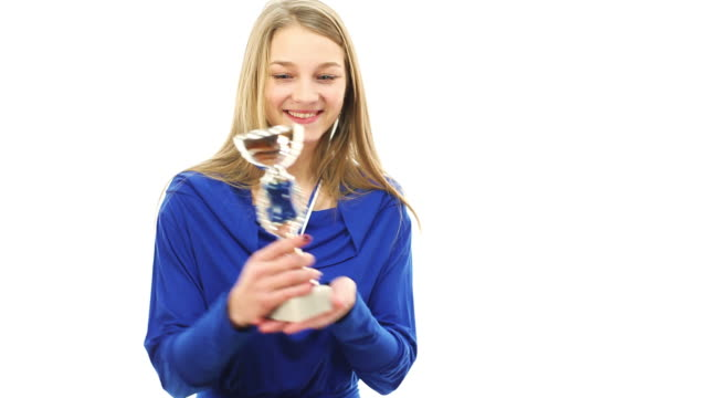 girl celebrating with trophy in hands Woman holding a winners trophy. Full HD 1920 x 1080 movie. less than 10 seconds stock videos & royalty-free footage