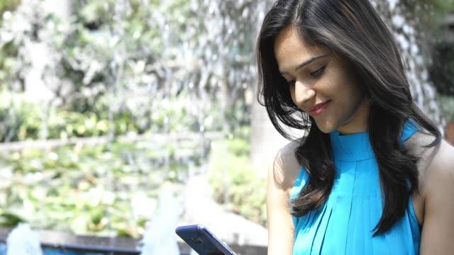 Girl Checking Social Media Feed Using Smartphone