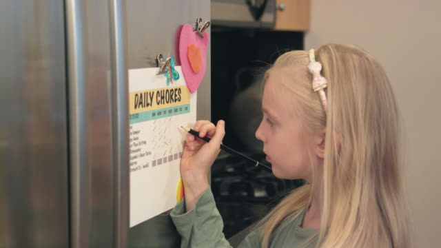 Girl Checks Off Chores from List video