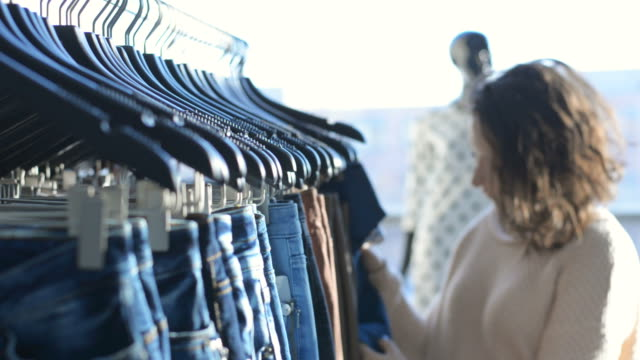 girl chooses clothes in shop - preppy fashion stock videos and b-roll footage