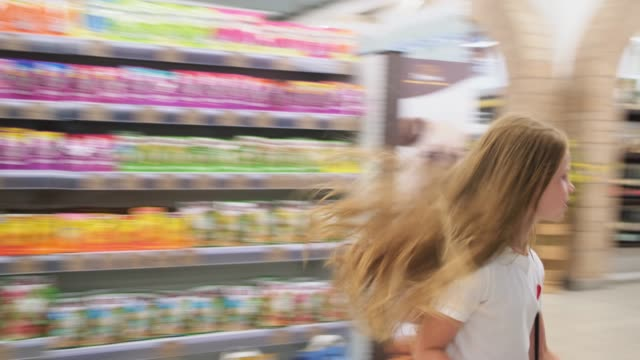Girl chooses products in the hypermarket video
