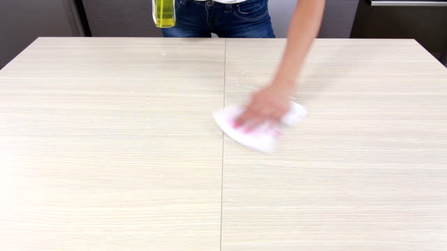 Girl cleaning and wiping table in kitchen Girl spraying, cleaning and wiping table in kitchen surface level stock videos & royalty-free footage