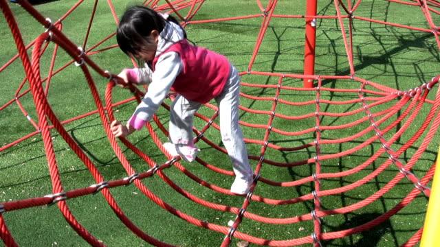 Girl Climbing Web At Playground video