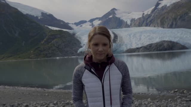 Girl Confidently Walking Away From Glacier