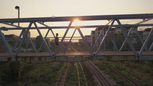 Girl crossing bridge