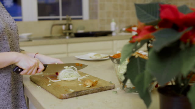 Girl cuts cabbage for salad video