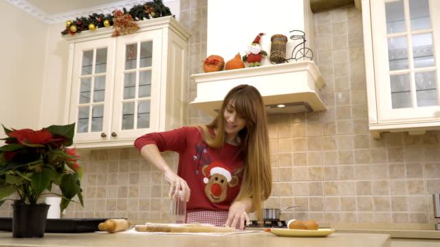 Girl cuts the cookies with glass from a raw dough video
