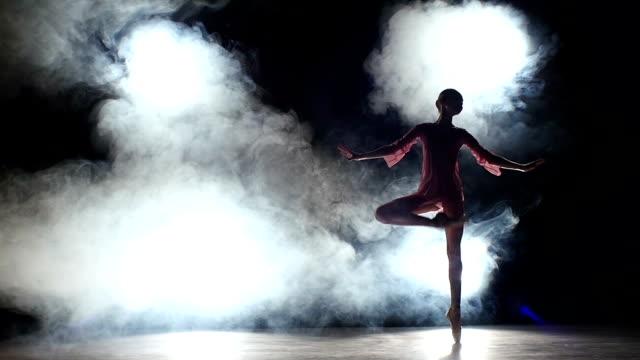 girl dancer dancing at studio.  silhouette. slow motion video