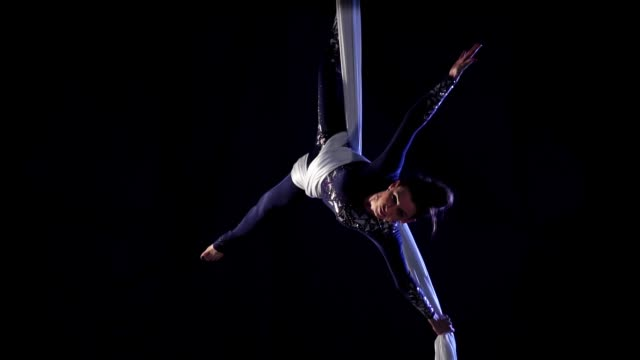 girl dancer on aerial silk. slow motion. aerial gymnastic. acrobatic show - circus стоковые видео и кадры b-roll