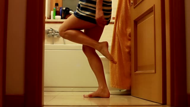 Girl dancing in bathroom Girl dancing in bathroom with towel bathroom stock videos & royalty-free footage