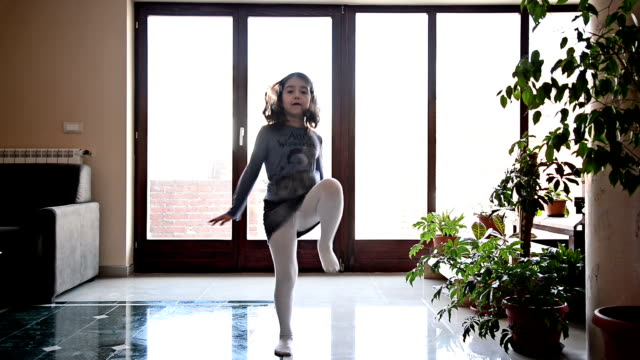 Girl dancing in the room. Cute,cheerful girl is at home. She is smiling,jumping and dancing in the living room. one girl only stock videos & royalty-free footage