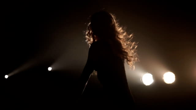 Girl dancing on the background of the spotlight. Silhouette Girl dancing on the background of the spotlight leotard stock videos & royalty-free footage