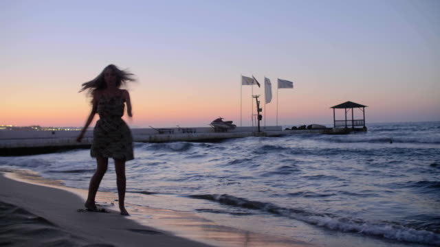 Girl Dancing on the Beach video
