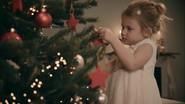 Girl decorating christmas tree video