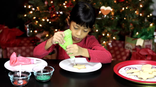 Girl Decorating Star Shaped Christmas Cookie video