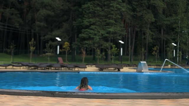 girl dives into the pool the girl dives into the pool swims competition group stock videos & royalty-free footage
