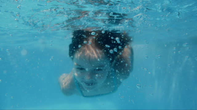 girl diving in swimming pool. slow motion- - young singles stock videos & royalty-free footage