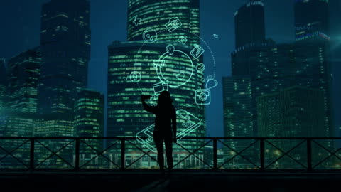 Girl does selfie on a background of skyscrapers and social media infographics The girl makes selfie against the background of the skyscrapers of the modern evening city and infographics about social media. computer graphic stock videos & royalty-free footage
