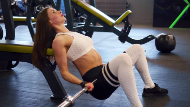 Girl doing hip thrust with barbell video