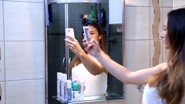 Girl doing self in the mirror video
