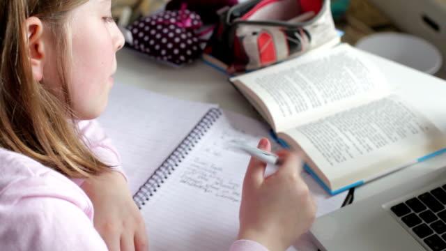 Girl Doing Written Homework In Bedroom video