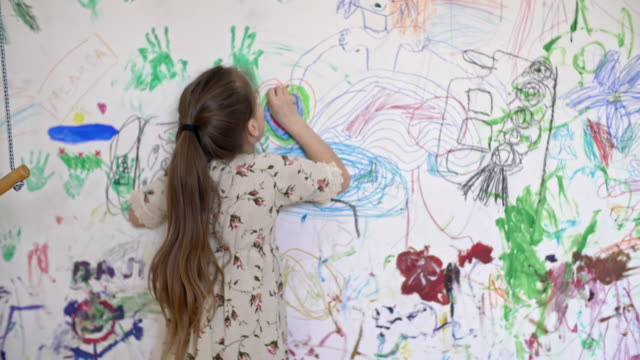 Girl Doodling on Room Wall video