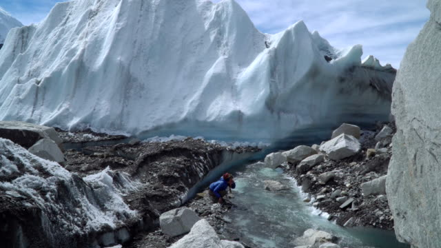 Girl drinking glacial water video