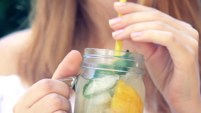 girl drinking iced tea with peach. - pesche bambino video stock e b–roll