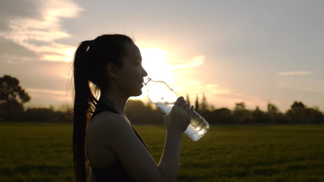 Girl drinks water after exercise – Video