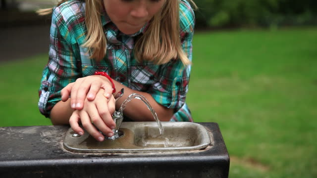 Girl drinks water from fountain  purified water stock videos & royalty-free footage