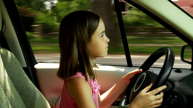 Girl driving a car video
