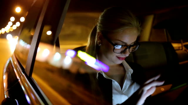 Girl driving at night in the taxi