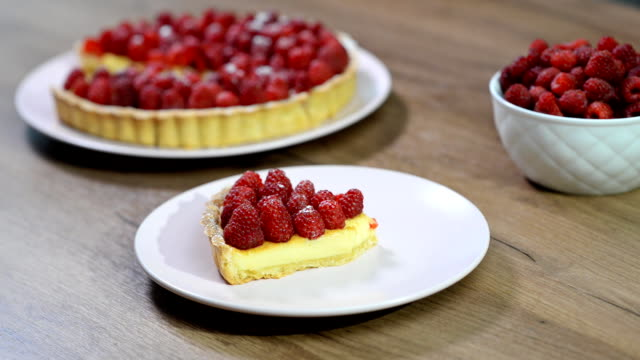 Girl eating a delicious raspberry tarts. Girl eating a delicious raspberry tarts. pastry dough stock videos & royalty-free footage