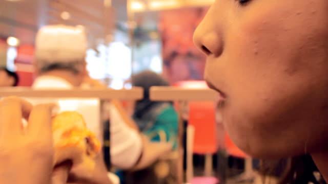 Girl eating Burger video