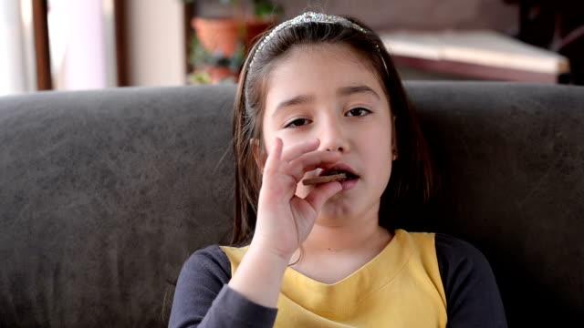 Girl eating chocolate video