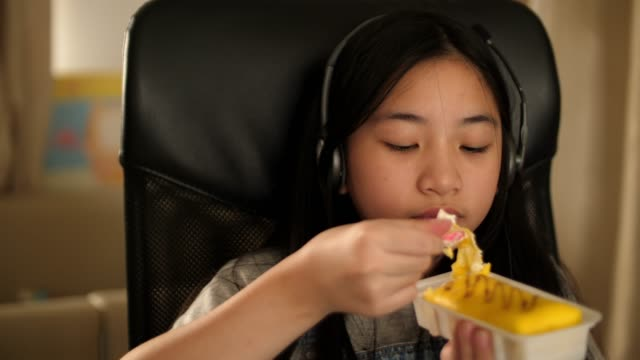 Girl eating food and listening the music