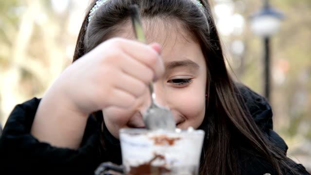 Girl eating hot chocolate. video