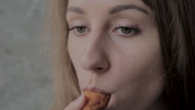 Girl eats nuggets in a fast food restaurant