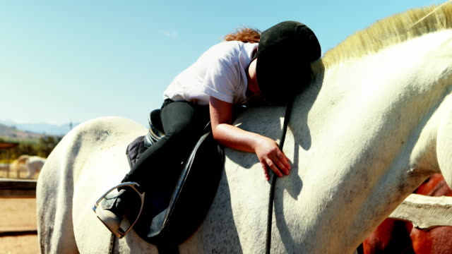 Girl embracing the white horse in the ranch 4k