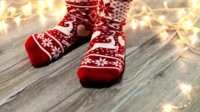 Girl enjoying in winter day in new socks Girl enjoying in winter day in new socks sock stock videos & royalty-free footage