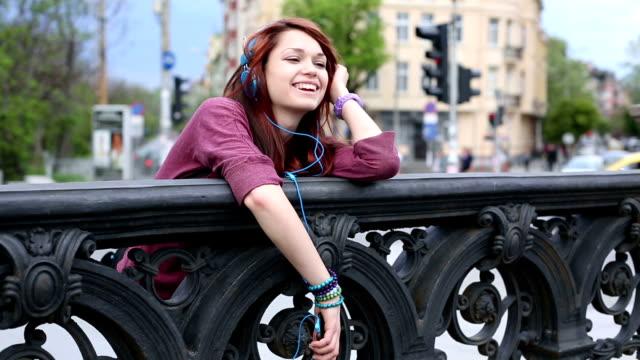 Girl enjoying the music video