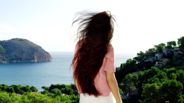 Girl enjoys the view from the terrace