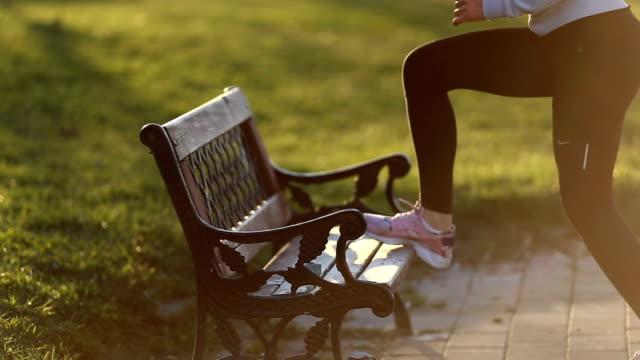 Girl exercising in public park video
