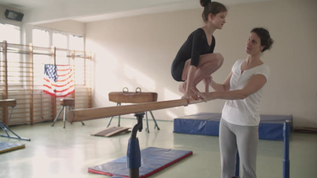 4K: Girl exercising on uneven bars. video
