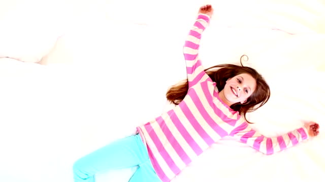 Girl falling onto bed video