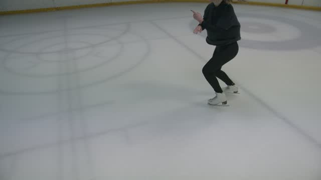 Girl figure skater is spinning on one leg Skating professional on ice skating. Close-up international match stock videos & royalty-free footage